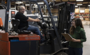 Team Members at Cimtech using the forklift